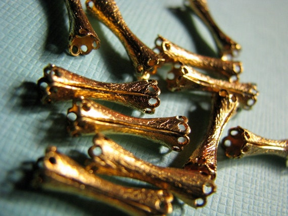 12 fancy vintage gold tube beads
