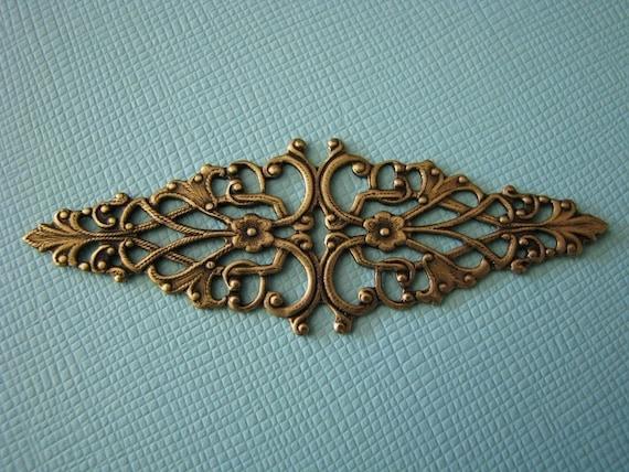Ornate brass bar filigree 2.5 inches