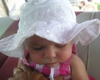 Girls white eyelet sun hat with chin strap