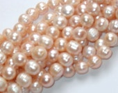 15 inch strand of cultured freshwater potato pearls 6-7mm peach