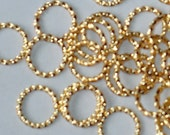 100 pcs of gold-plated fancy open  jumprings 10mm -16g