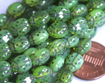 10 pcs of Green Lady Bug glass beads 6X8.5mm