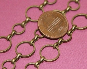 2 ft of Antiqued brass circle links chain 8mm-12mm (Lead safe- NIckel safe), bulk chain