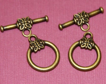 25 sets of antiqued  brass toggle with flower 16x14mm