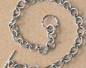 Antiqued Sterling silver fancy link bracelet with toggle clasp 71/2 inches