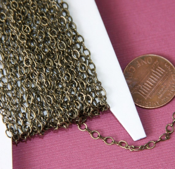 100 ft spool of Antiqued Brass Figure 8 Connector Chain 2.9X 3.3mm links, brass bulk chain, bulk figure 8 chain