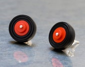 red tire studs