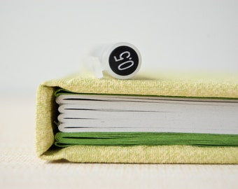 Recycled handbound pocket notebook with vinyl cover