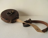 vintage tool style. leather and brass tape measure from welland ship canal. ontario. canada, made by chesterman, sheffield .england