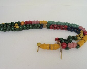 vintage sorting necklace. wooden beads and painted buttons strung on a shoestring