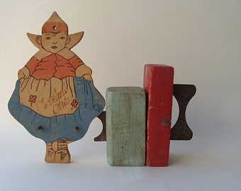 viintage handmade wooden souvenir with pegs from cleveland ohio in the shape of a dutch girl