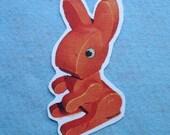 orange bunny looking left