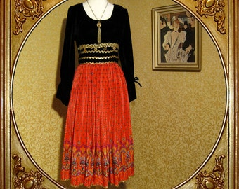 60s velvet and pleated ethnic print dress. gold ric rac trim.