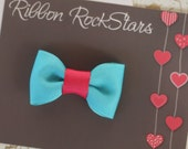 Turquoise and hot pink bow.