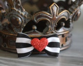 Black and white stripe bow with glitter red heart middle. Great Valentine's Day bow.