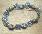 Tibetan Silver Swirly Shell/Snail Stretch Magic Slip-on Bracelet