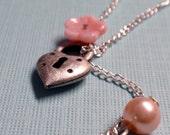 key to aphrodite . necklace .