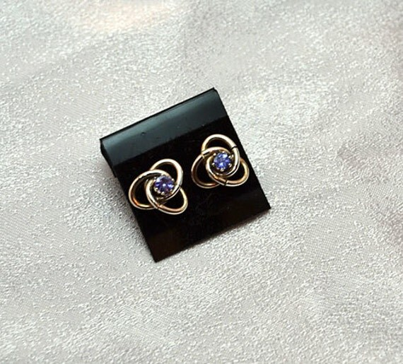 Celtic style sterling silver earring jackets with tanzanite studs