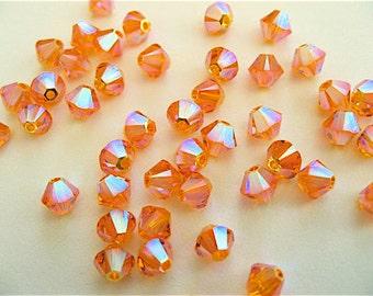 24 Sun AB2X Swarovski Crystal Beads Bicone 5328 4mm