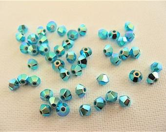 48 Turquoise AB2X Swarovski Crystal Beads Bicone 5328 3mm