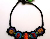 Necklace with five crocheted rings
