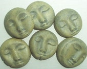 peaceful faces...blue-gray matte glaze but it looks greenish to me