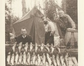 Great ANTIQUE CAMP PHOTO - Three Fisherman at Camp showing off  the days Catch - lots and lots of fish, fish creel and smoke rings around one mans head - neat shot