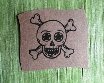 starry eyed skull and crossbones clear polymer stamp