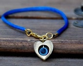 Blue string golden heart with rolling eye bead bracelet