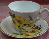 FINE BONE CHINA Cup and Saucer - Made in England by Consort - Yellow roses