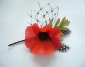 Pretty Orange Poppy Hairclip with Veiling and Guinea Feathers.