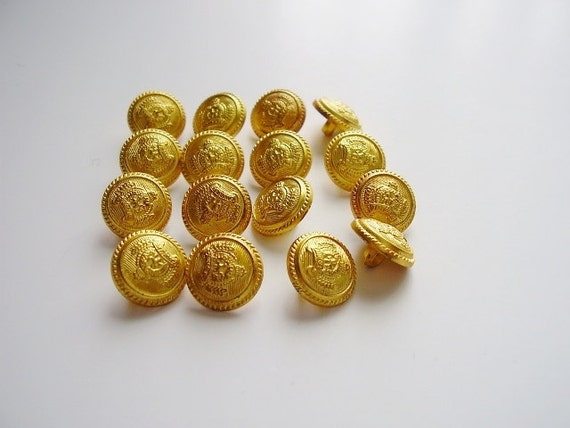 Golden plastic crest buttons  Small Set of 16
