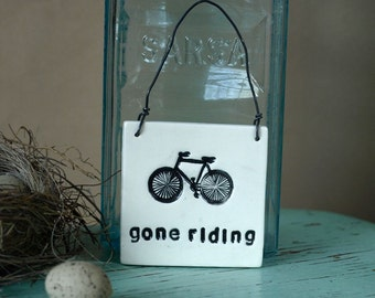 Ceramic Gone Riding Sign