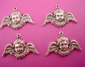 4 silver ox Angel Cherub curved  wing  charms 25mm