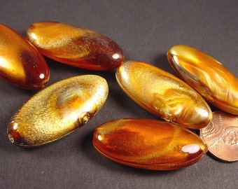 Vintage Amber mottled swirl  Plastic Oval  Beads  West German 35mm