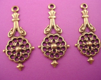 4 brass ox art nouveau heraldic art  nouveau  open cut charms loop 33mm