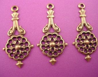 4 brass ox art nouveau heraldic art  nouveau  open cut charms loop