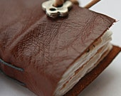 A KIT TO MAKE a tiny leather journal book for a necklace