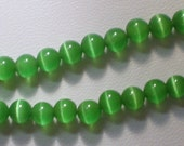 4mm Medium Green Cat's Eye Glass Bead 8 Inch Strand