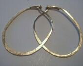 hoop earrings ..14kt gold filled..small..OVAL..flush catch..hoop earrings..
