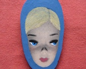 mysterious lady in blue hood brooch