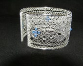 Silver bobbin lace bracelet with blue Swarovski crystals