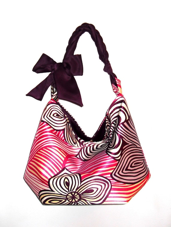 angie mini hobo tote in swirly abstract flower print with aubergine handle and lining