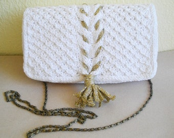 White cabled clutch with gold tassel