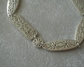 Cute Silvertone Cutwork Scroll Bracelet