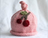 Baby girl knit hat with cherry applique.  Sizes newborn to big kid available.