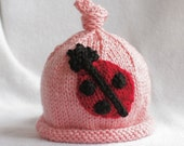 baby girl hand knit hat with ladybug applique.  sizes newborn-big kid available.