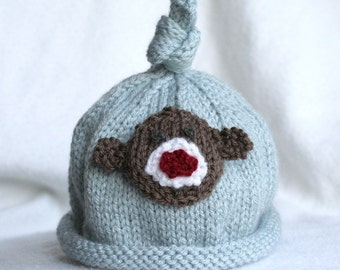 Baby boy knit hat with monkey and banana applique.  Sizes newborn-big kid available.