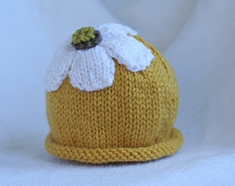 Baby girl knit hat with pretty petaled flower.  Sizes newborn to big kid available