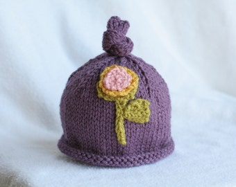 Girl's knit hat with sweet flower applique.  Sizes newborn to big kid available.